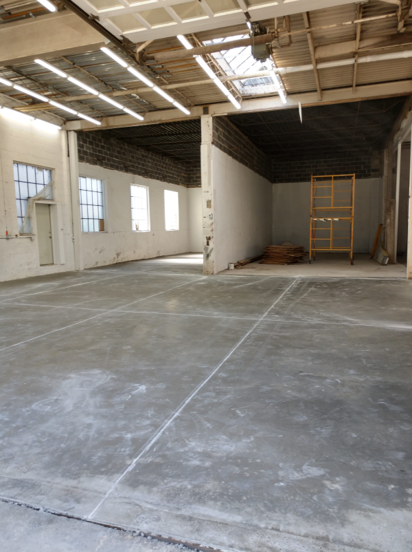 An industrial warehouse facility with a new concrete floor poured by Dornbrook Construction