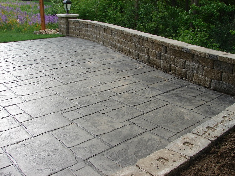 Stamped Concrete Patio with Retaining Wall